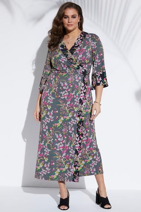 Artikel klicken und genauer betrachten! - Kimono-Wickelkleid in Maxilänge aus elastischem Jersey. Asiatisch anmutendes It-Piece für den Sommer. Passt sich durch die raffinierte Bindung perfekt der Silhouette an. Je nachdem, wie es gebunden wird, verändert sich die Optik. Mal sexy und dekolletiert, mal mit weniger tiefem V-Ausschnitt. V-Ausschnitt. Weite 3/4 Statementärmel. | im Online Shop kaufen
